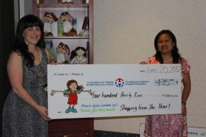 Julia presents donation to MCHF in 2012